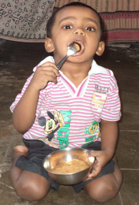 kid eating palm sugar 2